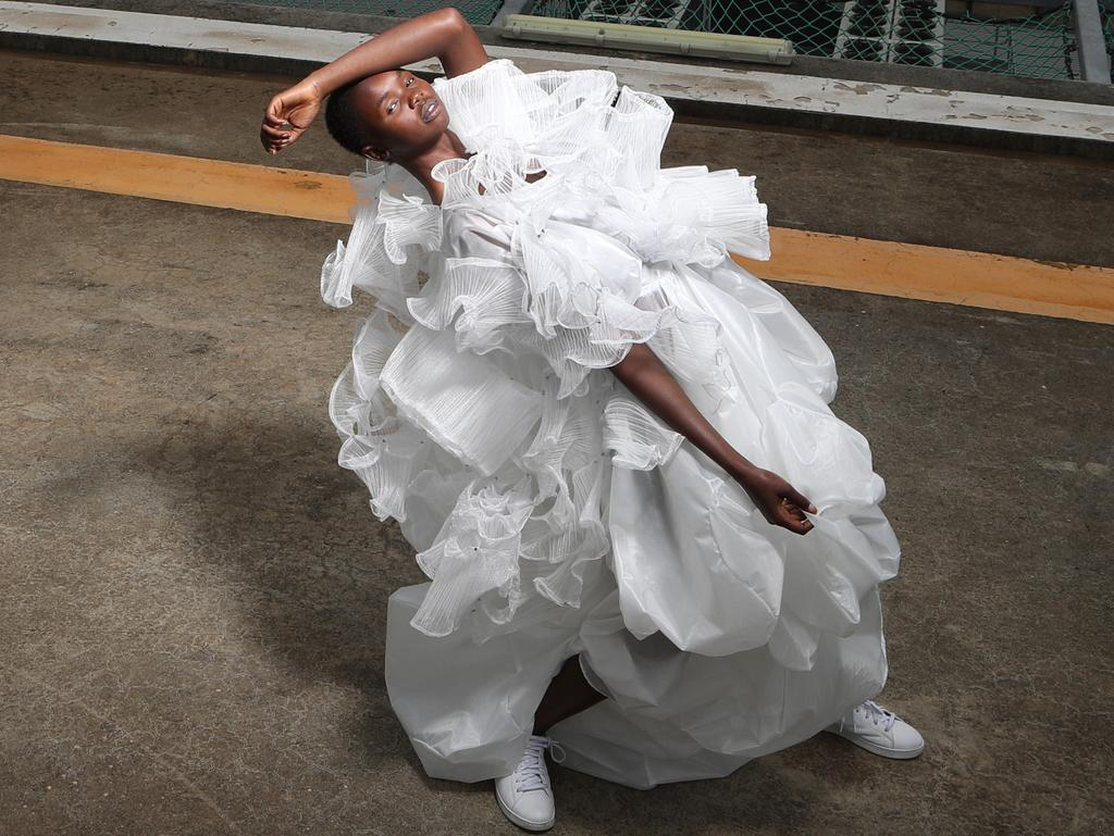 <s1>  FLOATING ON AIR: Face of the Adelaide Fashion Festival Akiima in Couture+Love+Madness designer Cristina Tridente's Cloud dress and cape. </s1>  <s1>  <b><b>Picture: KELLY BARNES<p></p></b></b> </s1>