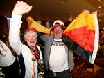 Christie and Mawfred Kramichi seem relatively pleased with German's win. Picture: Simon Cross