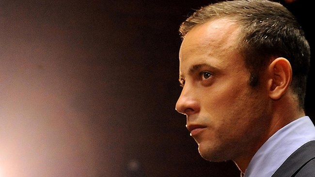 CHARGED: Oscar Pistorius, in court in Pretoria charged with the shooting death of his girlfriend, Reeva Steenkamp.