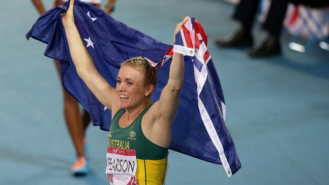 Sally Pearson celebrates after winning the women's 100m hurdles final. Picture: Adam Head.