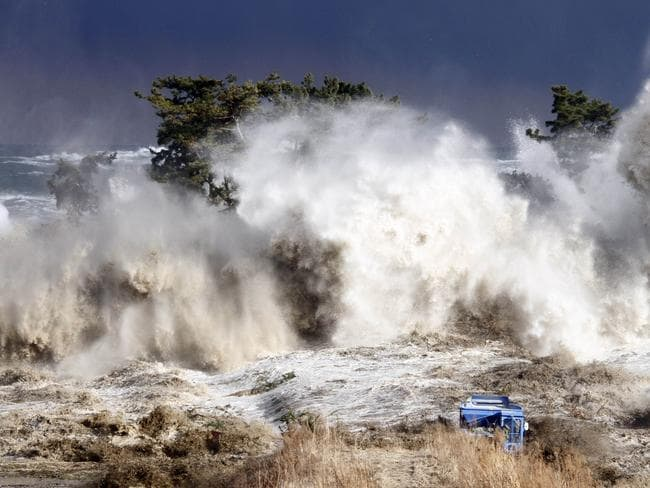Tsunami waves hit the coast of Minamisoma in Fukushima prefecture following massive earthquake that hit the Japanese north-eastern coast in this image taken by Sadatsugu Tomizawa and released via Jiji Press.