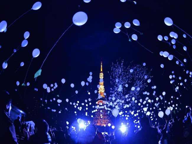People release balloons to celebrate the New Year at the Prince Park Tower in Tokyo.