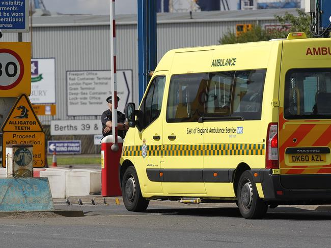 Health crisis ... An ambulance arrives at the entrance to Tilbury Docks.