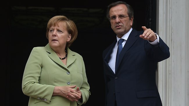 Greek Prime Minister Antonis Samaras (R) welcomes German Chancellor Angela Merkel before their meeting in Athens on October 9, 2012. Merkel's first visit to Greece since the debt crisis erupted almost three years ago, as protestors geared up for a major show of discontent against painful austerity cuts. AFP PHOTO / ARIS MESSINIS