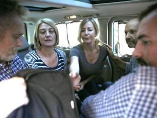 UPLOADED IMAGE - Australian TV journalist Tara Brown, second left, and Sally Faulkner, center, the mother of the two Australian children, sit in a mini van between the three crew members of Channel 9 Australian TV, after they released from the Lebanese jail, in Baabda east of Beirut, Lebanon, Wednesday April 20, 2016. An Australian mother and TV crew caught up in a high-profile child custody battle and detained in Beirut amid a botched attempt to take the woman's two children from their Lebanese father have been released on bail. (AP Photo/Hussein Malla)