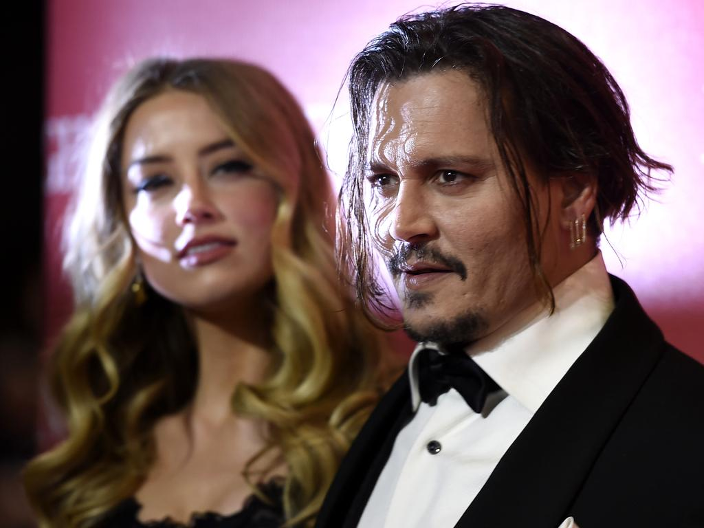 Amber Heard, left, and Johnny Depp arrive at the 27th annual Palm Springs International Film Festival Awards Gala on Saturday, Jan. 2, 2016, in Palm Springs, Calif. Picture: Jordan Strauss/Invision/AP