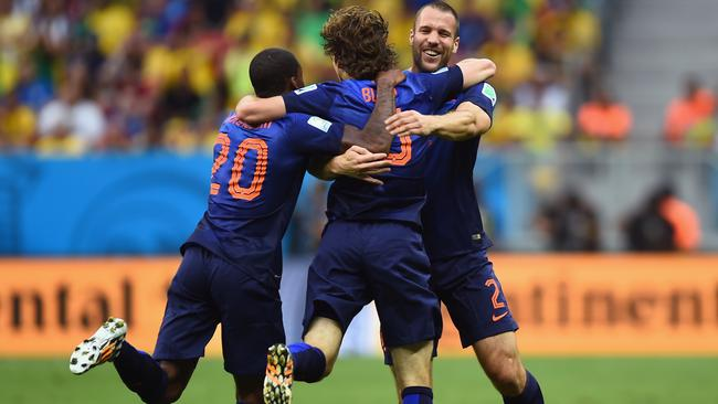 Daley Blind celebrates scoring the Dutch second against Brazil.