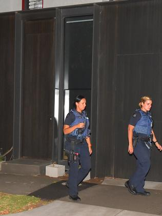 Police leave the townhouse where Whole Pentry founder, Belle Gibson, lives. Picture: Jay Town