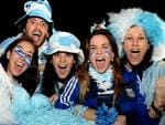 Excited Argentinian supporters, from left, Paula Gonzalez, Pippo Belmonte, Sonia Bogoslavsky, Carla Baldoni and Lorena Palmisano. at La Boca for the World Cup final. Picture: Noelle Bobrige