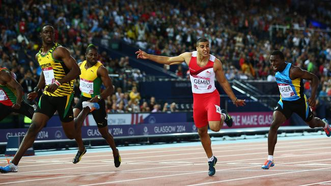 Kemar Bailey-Cole crosses the line ahead of England's Adam Gemili.