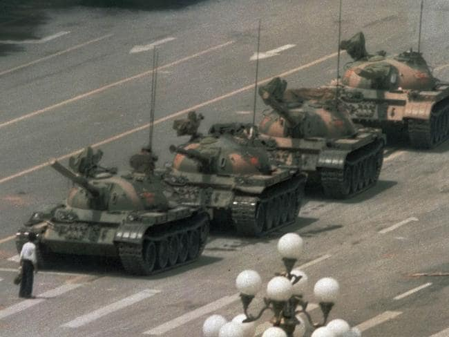 Historic moment ... a lone Chinese man standing to block a line of tanks heading east on Beijing's Changan Blvd. near Tiananmen Square in 1989.