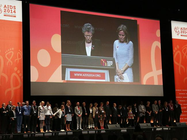 One minute's silence is held during the 20th International AIDS Conference at The Melbourne Convention and Exhibition Centre yesterday.