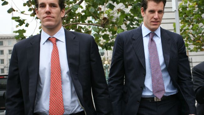 Cameron (L) and Tyler (R) Winklevoss are now Bitcoin billionaires. Photo: AFP