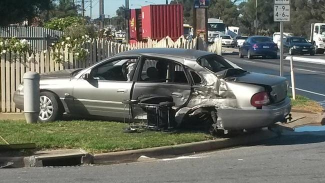 A Holden Statesman which was damaged in a collision with a truck at the corner of Tapleys