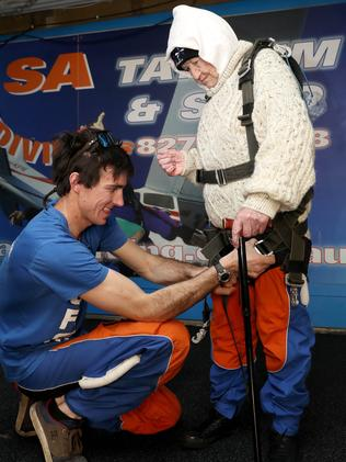 Bryce Sellick readies Mrs O'Shea's harness. Picture: Calum Robertson