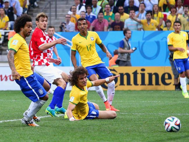 Brazil's Marcelo watches on in horror as his own goal gives Croatia an early lead in the 2014 FIFA World Cup opening match.