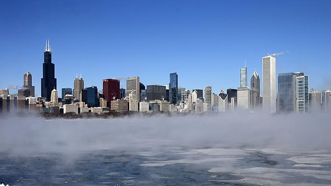 The Chicago Skyline sits as a backdrop as fog drifts across Monroe Harbor with temperatures well below zero.