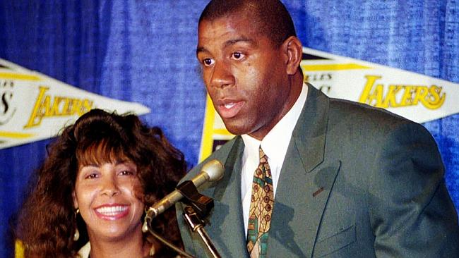 Earvin 'Magic' Johnson with wife Cookie at press conference in 1992.