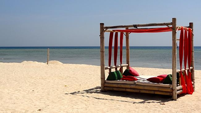 A day bed on the beach out the front of Hotel Tugu. Picture: Kristy Symonds