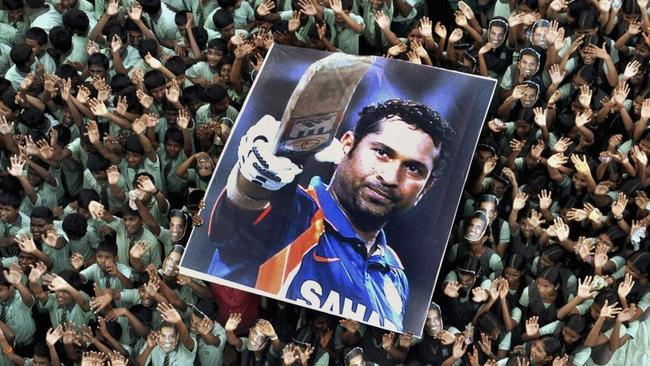 The adoration of Tendulkar is not in doubt, as shown by Indian students holding a large poster of him.