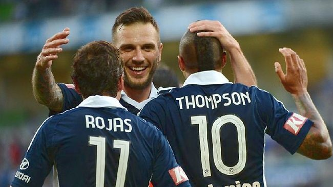 Melbourne Victory's Billy Celeski (facing), Archie Thompson and Marcos Rojas celebrate after Rojas set up Thompson's goal in the first half. Picture: George Salpigtidis