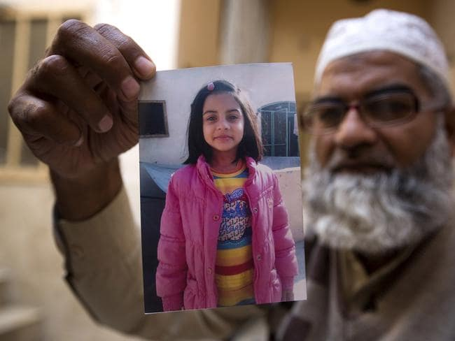 Mohammed Amin shows a picture of his seven year-old daughter, Zainab Ansari. Picture: AP