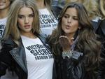 <p>Victoria's Secret models Rosie Huntington-Whiteley and Izabel Goulart pose in Times Square November 18, 2009 to celebrate the return of the Victoria's Secret Fashion Show to New York.</p>