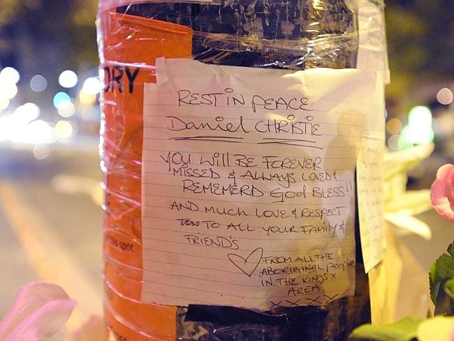 Messages of condolence were placed on a light pole in Kings Cross for one-punch victims Thomas Kelly and Daniel Christie.