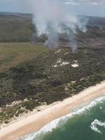 Campers have been evacuated from the eastern side of North Stradbroke Island as bushfires rage. Pic: Phil Norrish from Channel 7 helicopter