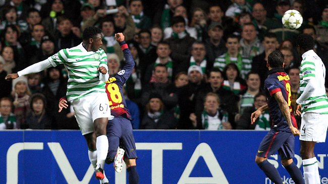 CHAMPIONS LEAGUE: Celtic's Victor Wanyama, left, scores his goal past Barcelona's Jordi Alba at Celtic Park. Celtic won 2-1. Picture: Scott Heppell