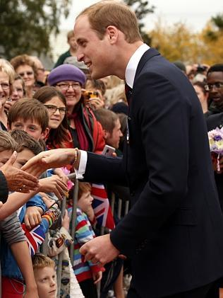 Prince William, Duke of Cambridge speaks with members of the crowd at a ceremony at the war memorial in Seymour Square. Picture: Getty Images