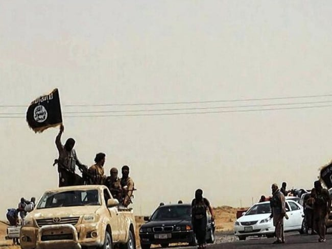 Pushing forward ... ISIS militants surge through Salaheddin province.