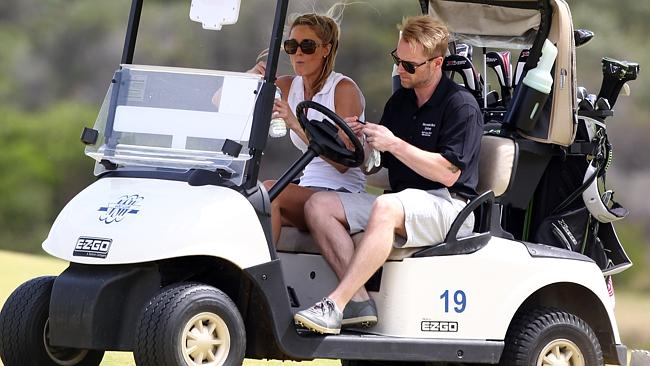 I may be driving the cart, but you're driving me crazy baby. Good one ... now drive. Photo: Splash News