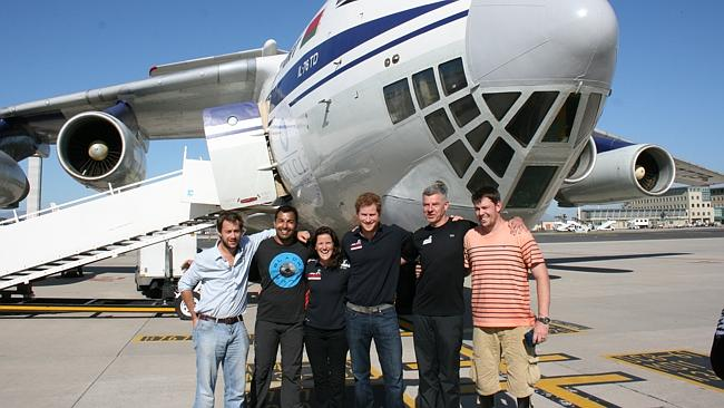 Team UK members from left, Guy Disney, Ibrar Ali, Kate Philp, Prince Harry, Richard Eyre and Duncan Slater at the start of the South Pole Allied Challenge 2013 expedition as they leave Cape Town for a flight to Nova, Antarctica. Picture: Walking With The Wounded/AP