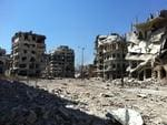 The Battle for Homs: After months of fighting, the Syrian Army have retaken a devasted Homs in scenes reminiscent of the Battle for Berlin in 1945. Photo: AFP/Shaam News Network