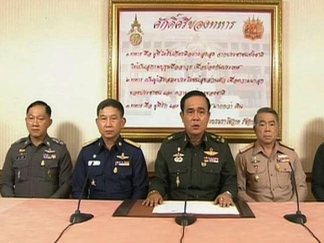 Coup announced ... Thailand General Prayut Chan-O-Cha (centre) announces in a televised address to the nation that the armed forces have seizing power after months of deadly political turmoil. Picture: AFP PHOTO / Thai television
