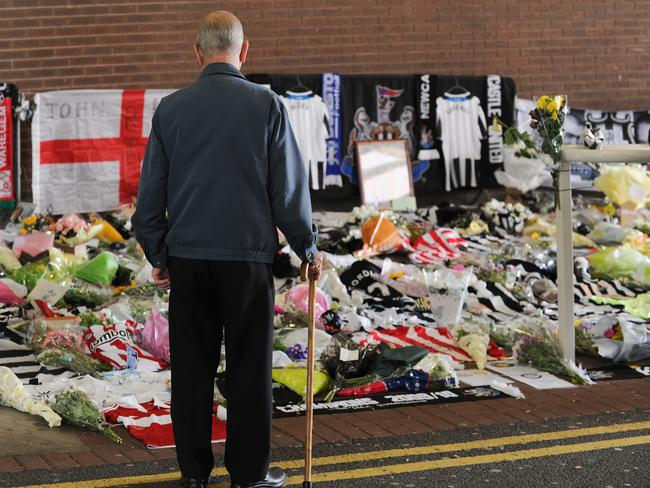 A man looks on at flowers and tributes that were left at St James's Park, home of Newcastle United Football Club in honour of John Alder and Liam Sweeney on July 22, 2014 in Newcastle upon Tyne, England. The two lifelong Newcastle fans died along with 296 others in the Malaysian flight MH17 disaster in the Ukraine. Picture: Getty