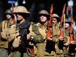 Men dressed as WWI soldiers take part in an Anzac Day parade in Brisbane. Picture: Dan Peled/AAP