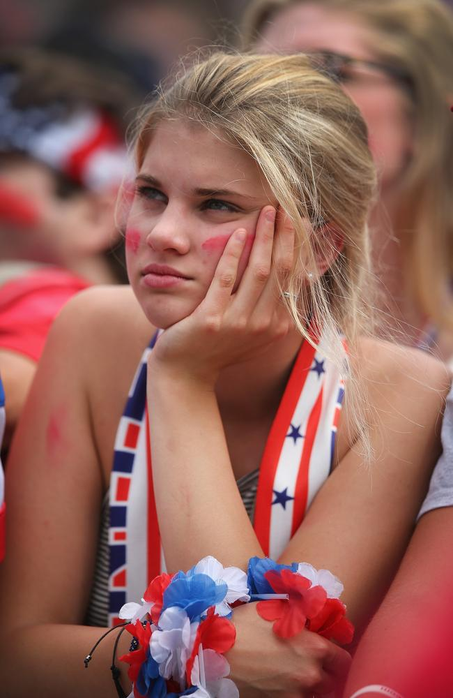 A fan in Chicago watches USA play Germany.