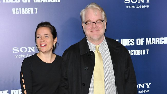 "Mimi O'Donnell and Philip Seymour Hoffman attend the premiere of ""The Ides of March"" at the Ziegfeld Theater on October 5, 2011. Photo: Stephen Lovekin/Getty Images"