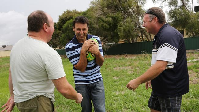 Daley in Junee with his old school buddies, Scott Duncan (L) and Craig Bradley (R).