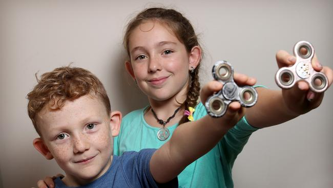 Fid spinners The small toy first designed for therapy has Cairns