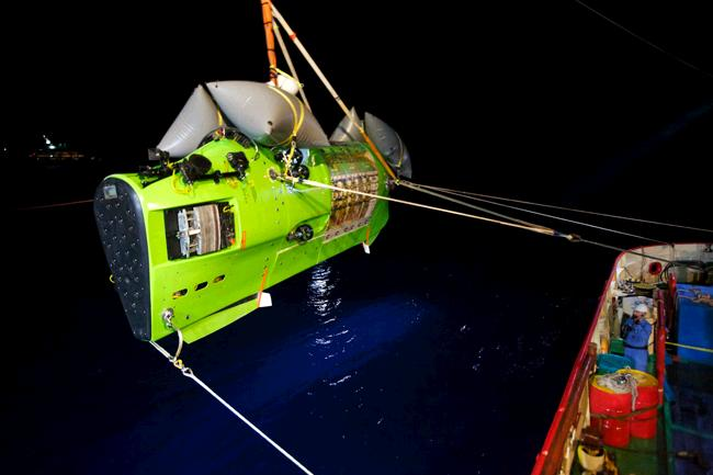 The Deepsea Challenger submersible carrying filmmaker and National Geographic Explorer-in-Residence James Cameron is hoisted into the Pacific Ocean on its way to the Challenger Deep, the deepest part of the Mariana Trench. Picture: Mark Thiessen / National Geographic