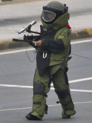 A protective bomb suit ... worn by a policeman. Picture: AFP