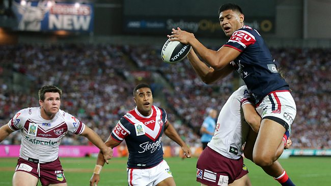 Daniel Tupou leaps high to score for the Roosters in the first half. Picture: Gregg Porteous