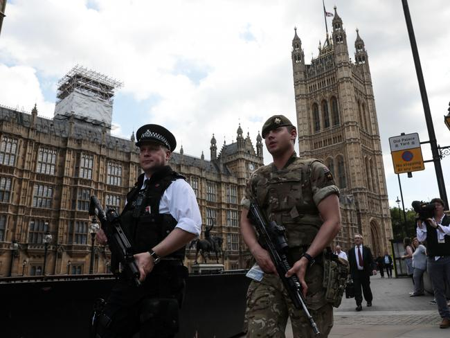 "A soldier and an armed police officer patrol outside the Palace of Westminster in London in May as UK authorities roll out the biggest homeland deployment of troops in decades to prevent an ""imminent"" terrorist attack. Picture: Simon Dawson/Bloomberg"