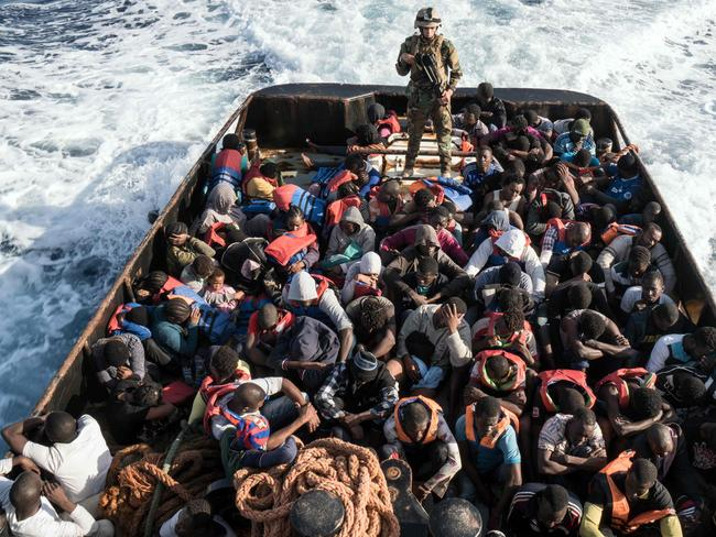 A Libyan coast guardsman stands on a boat during the rescue of 147 illegal immigrants attempting to reach Europe off the coastal town of Zawiyah last month. Picture: AFP