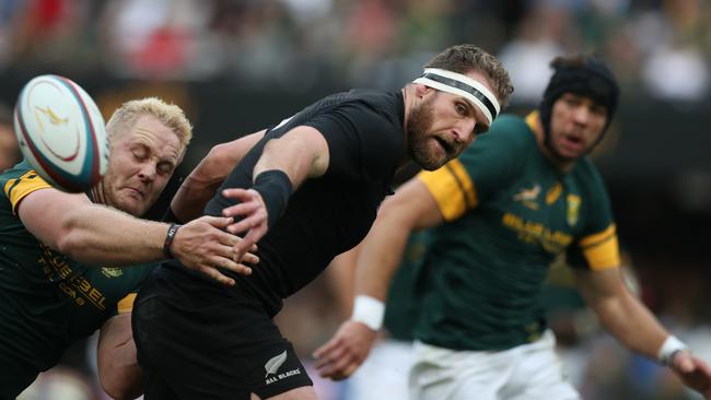 All Blacks captain Kieran Read flicks a pass during the record 57-15 rout in Durban last year.