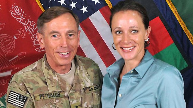 Davis Petraeus, left, shakes hands with his biographer Paula Broadwell, co-author of All In: The Education of General David Petraeus, pictured together in July 2011.