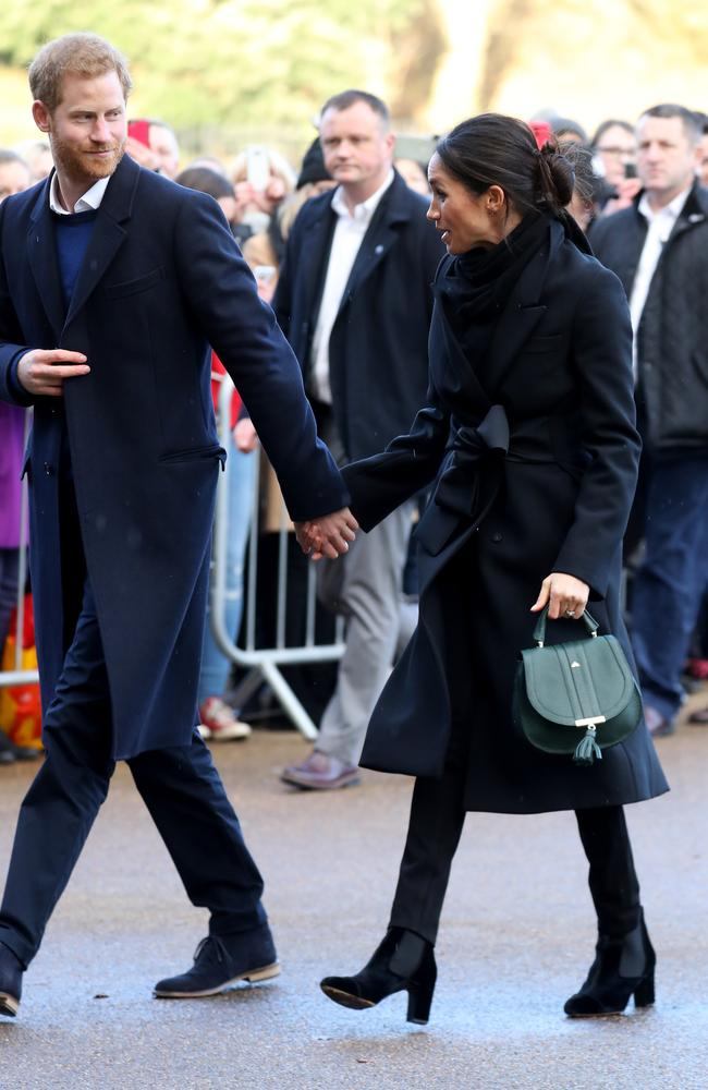 Holding hands? Tick. Wearing black? Tick. Meghan is breaking all the royal rules. Picture: Chris Jackson/Getty Images